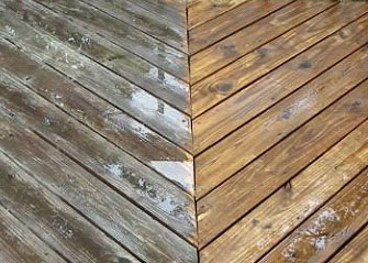 Before and after photo of a wooden deck that has been pressure washed